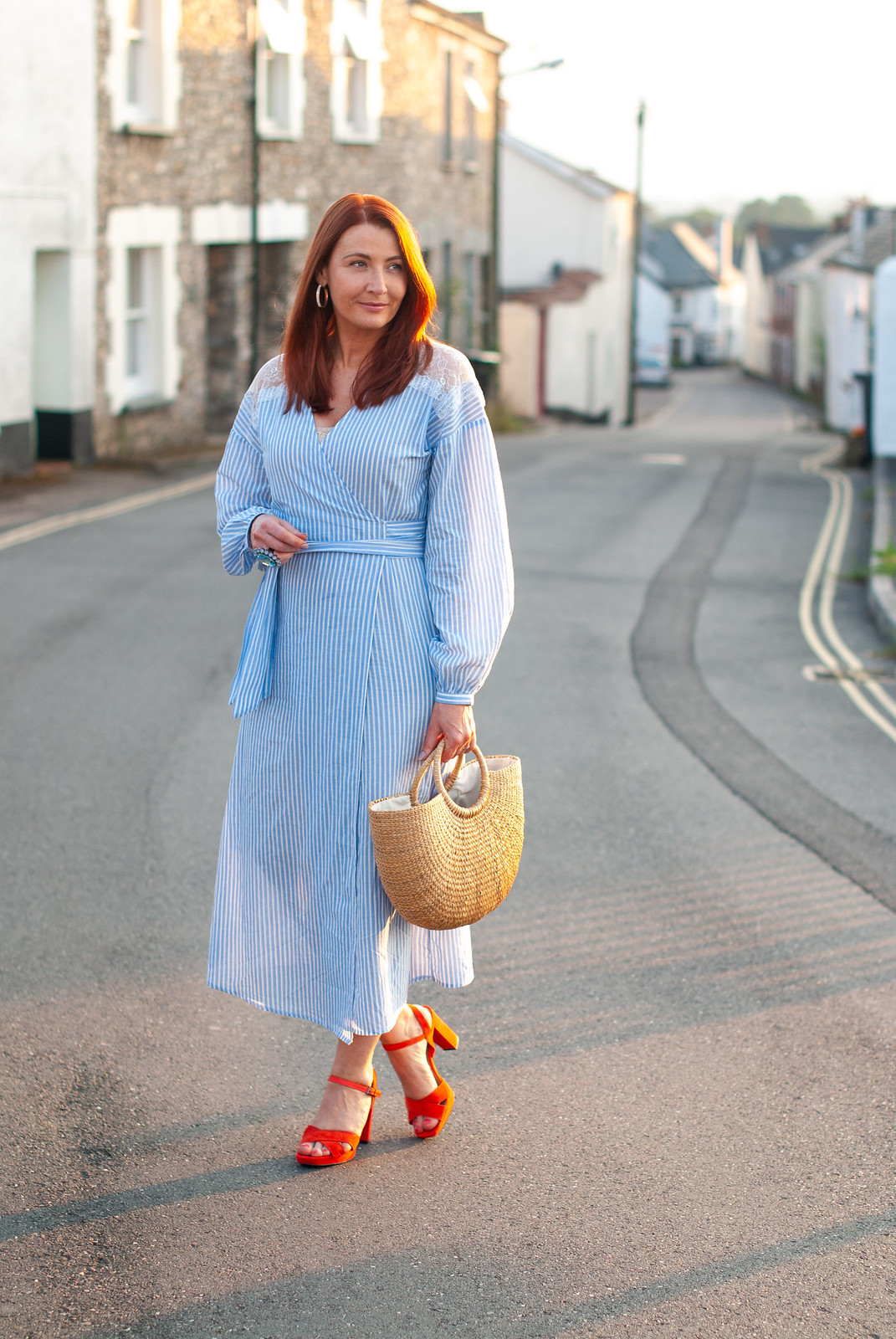 A Classic Summer Outfit of Blue and White Stripe Cotton \ Mango stripe cotton dress with lace panel \ tomato red block heel sandals \ straw basket bag | Not Dressed As Lamb, over 40 style