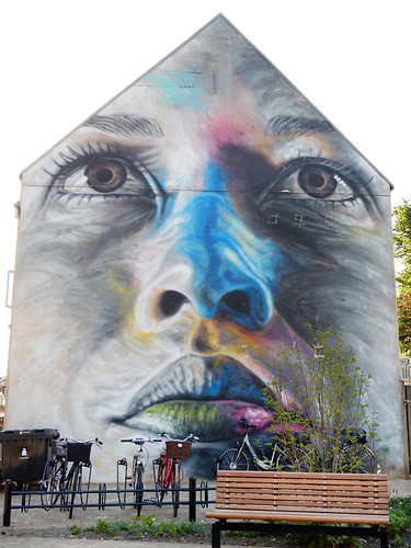 Mural of a face on a house in Aalborg, Denmark