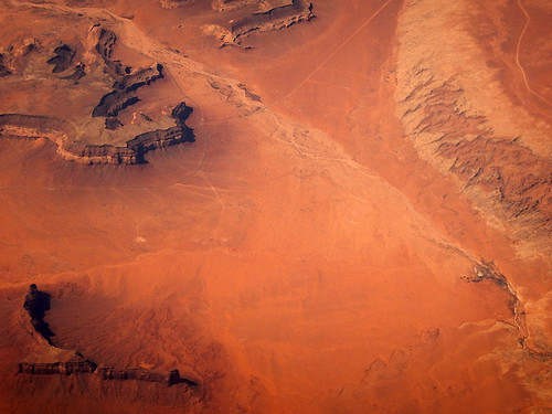 Aerial shot of a red desert from our flight across the southwest US to Mexico City