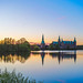Frederiksborg Castle and the little ferry, Hillerød, Denmark