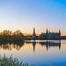 Frederiksborg Castle and the little ferry, Hillerød, Denmark