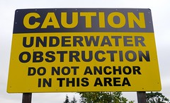 Caution sign facing the Willamette River in Eugene, Oregon