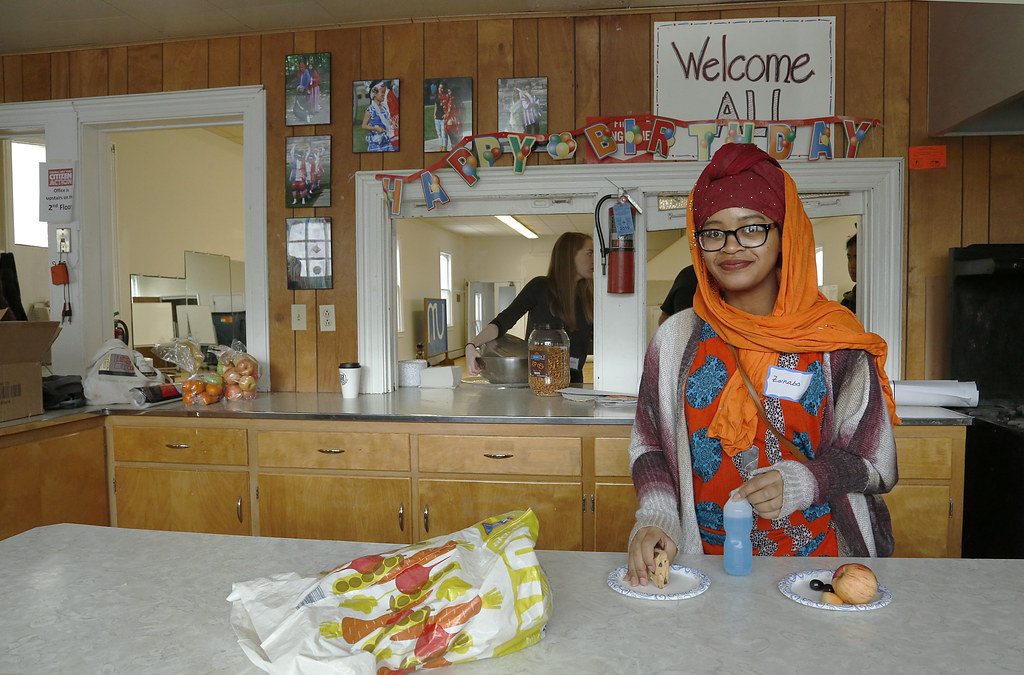 A community member and open house participant in the MUCC kitchen.