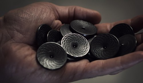 Handfull of Black Hole spinner coins