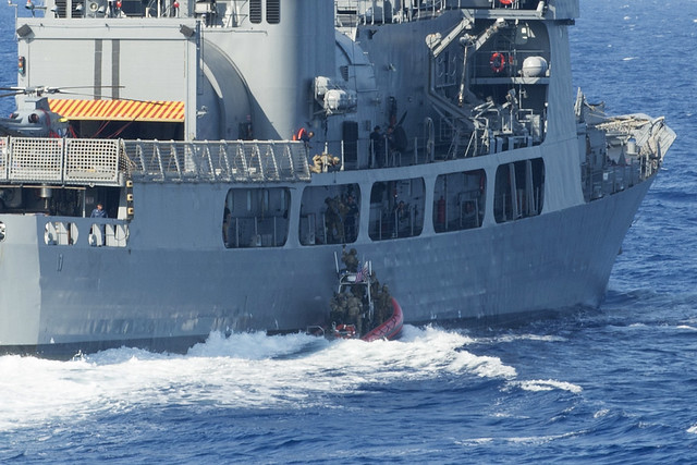 PACIFIC OCEAN (July 16, 2018) A Coast Guard Tactical Delivery Team (TDT) perform a hook and climb operation to board the Philippine Navy frigate BRP Andrés Bonifacio (FF 17) during a training operation as part of Rim of the Pacific (RIMAPC) exercise, July 16. TDT members are part of the Coast Guard's Maritime Security Response Team-West, and routinely train to board compliant and non-compliant vessels. Twenty-five nations, 46 ships, five submarines, about 200 aircraft and 25,000 personnel are participating in RIMPAC from June 27 to Aug. 2 in and around the Hawaiian Islands and Southern California.  The world's largest international maritime exercise, RIMPAC provides a unique training opportunity while fostering and sustaining cooperative relationships among the participants critical to ensuring the safety of sea lanes and security on the world's oceans.  RIMPAC 2018 is the 26th exercise in the series that began in 1971.  (U.S. Coast Guard photo by Petty Officer 2nd Class David Weydert/Released)