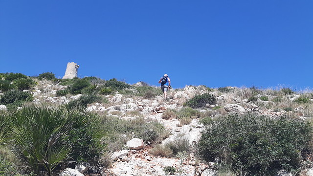 Terry hiking up a mountain to reach Torre el Gerro, Denia Spain.
