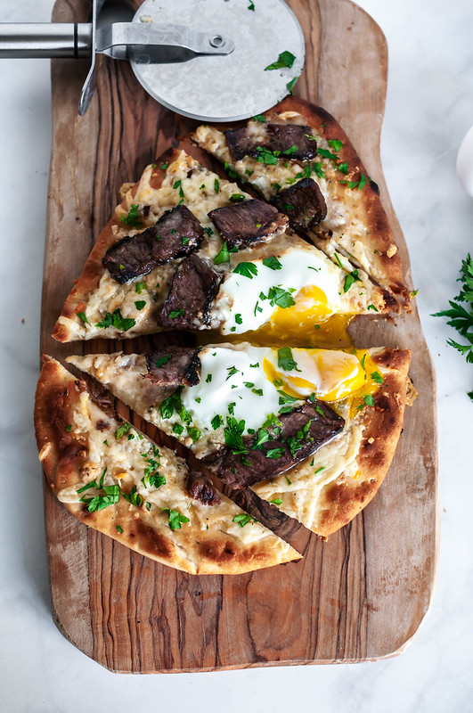 You no longer need an excuse to eat pizza for breakfast with this Steak and Egg Flatbread Pizza. Two cheese, juicy, marinated steak and a drippy egg combine into the ultimate breakfast, lunch or dinner pizza.