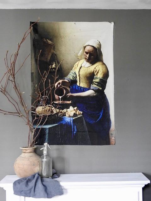 Kruik met takken schilderij vrouw met melkkan