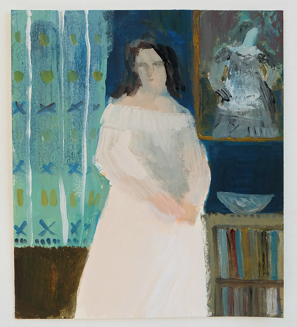 woman with portrait and bookcase