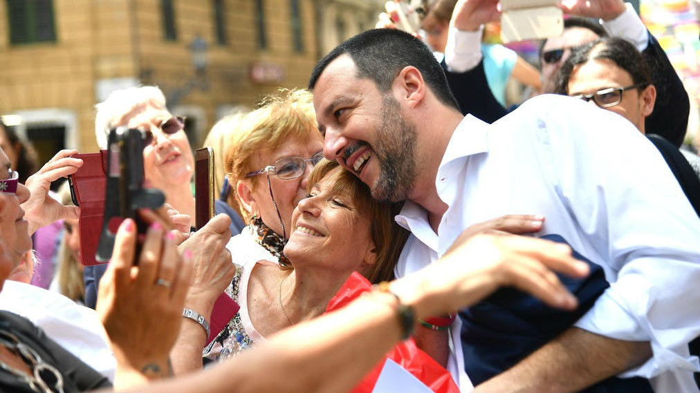 Matteo Salvini smiling for photos with Italian voters