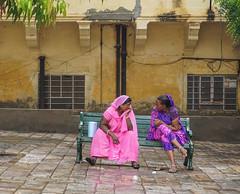 Indian women sitting on bench