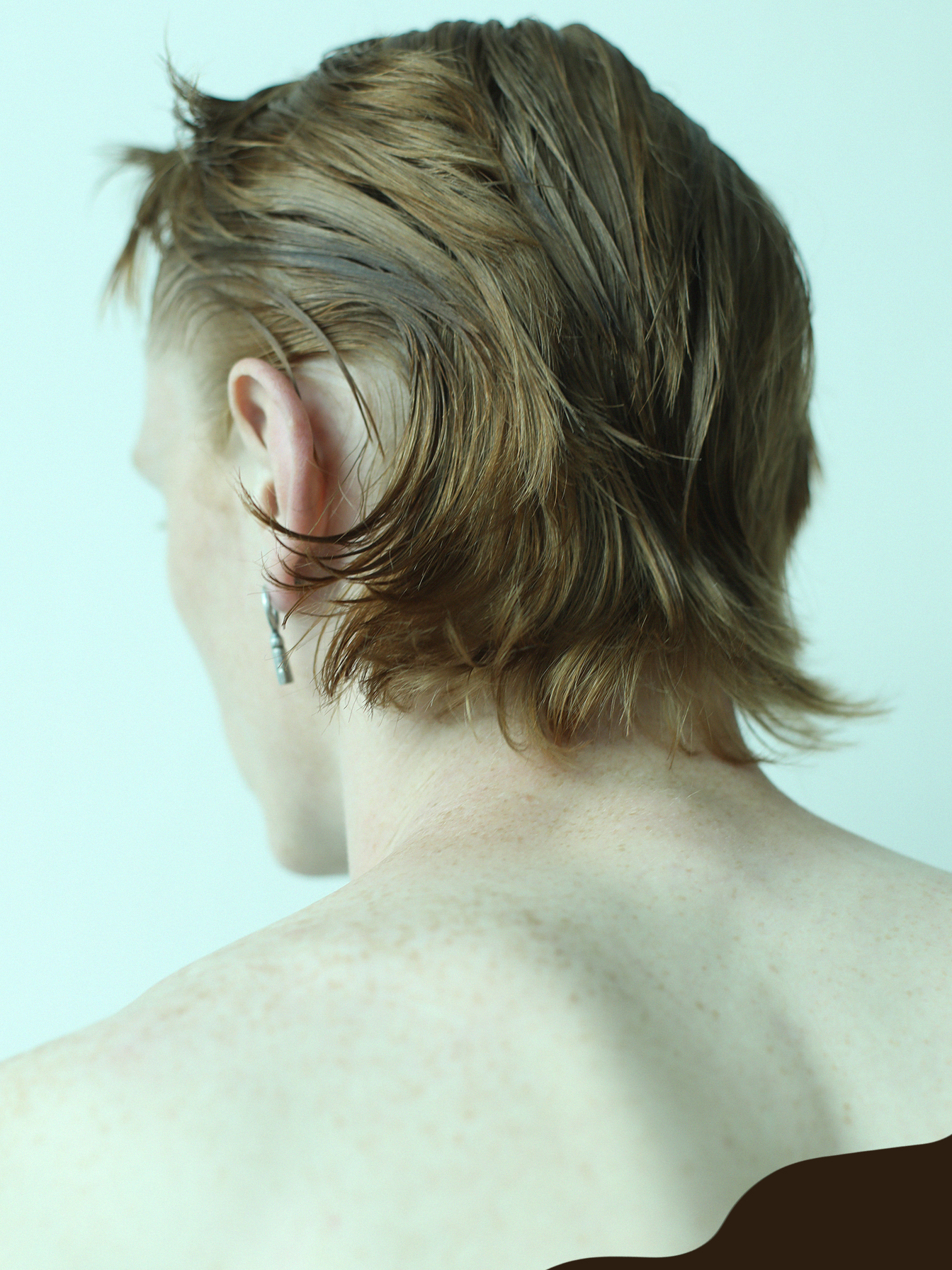 back portrait of jordan wain with brown shape