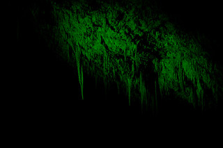 Stalactites in Jewel Cave in green light