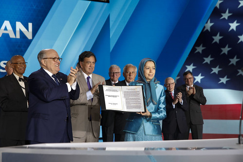"Mayor Rudy Giuliani presents the statement signed by 33 U.S. dignitaries and former officials to Maryam Rajavi at the ""Free Iran – The Alternative"" gathering – Villepinte, June 30, 2018"