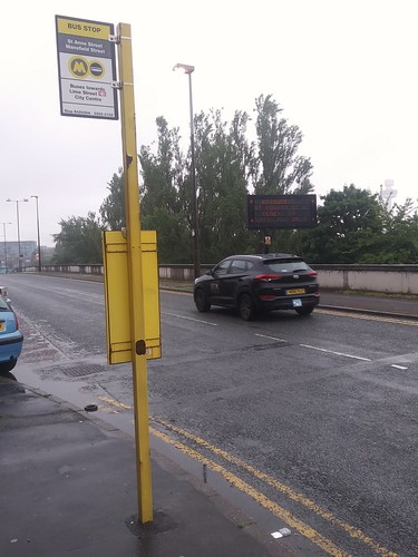 Bus stop sign stanchion is yellow, Merseytravel, Liverpool