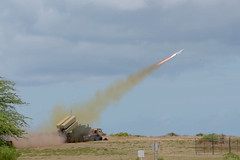 KAUAI, Hawaii (July 12, 2018) A Naval Strike Missile (NSM) is launched from the back of a Palletized Load System (PLS) by the U.S. Army at Pacific Missile Range Facility Barking Sands, targeting the ex-USS Racine (LST 1191), positioned at sea, during a sinking exercise as part of Rim of the Pacific (RIMPAC) 2018. This marks the first time the U.S. Army has participated in a sinking exercise during RIMPAC. Twenty-five nations, 46 ships, five submarines, about 200 aircraft, and 25,000 personnel are participating in RIMPAC from June 27 to Aug. 2 in and around the Hawaiian Islands and Southern California. The world's largest international maritime exercise, RIMPAC provides a unique training opportunity while fostering and sustaining cooperative relationships among participants critical to ensuring the safety of sea lanes and security of the world's oceans. RIMPAC 2018 is the 26th exercise in the series that began in 1971. (Captured from a video by U.S. Air Force Airman 1st Class Nathan Barbour)
