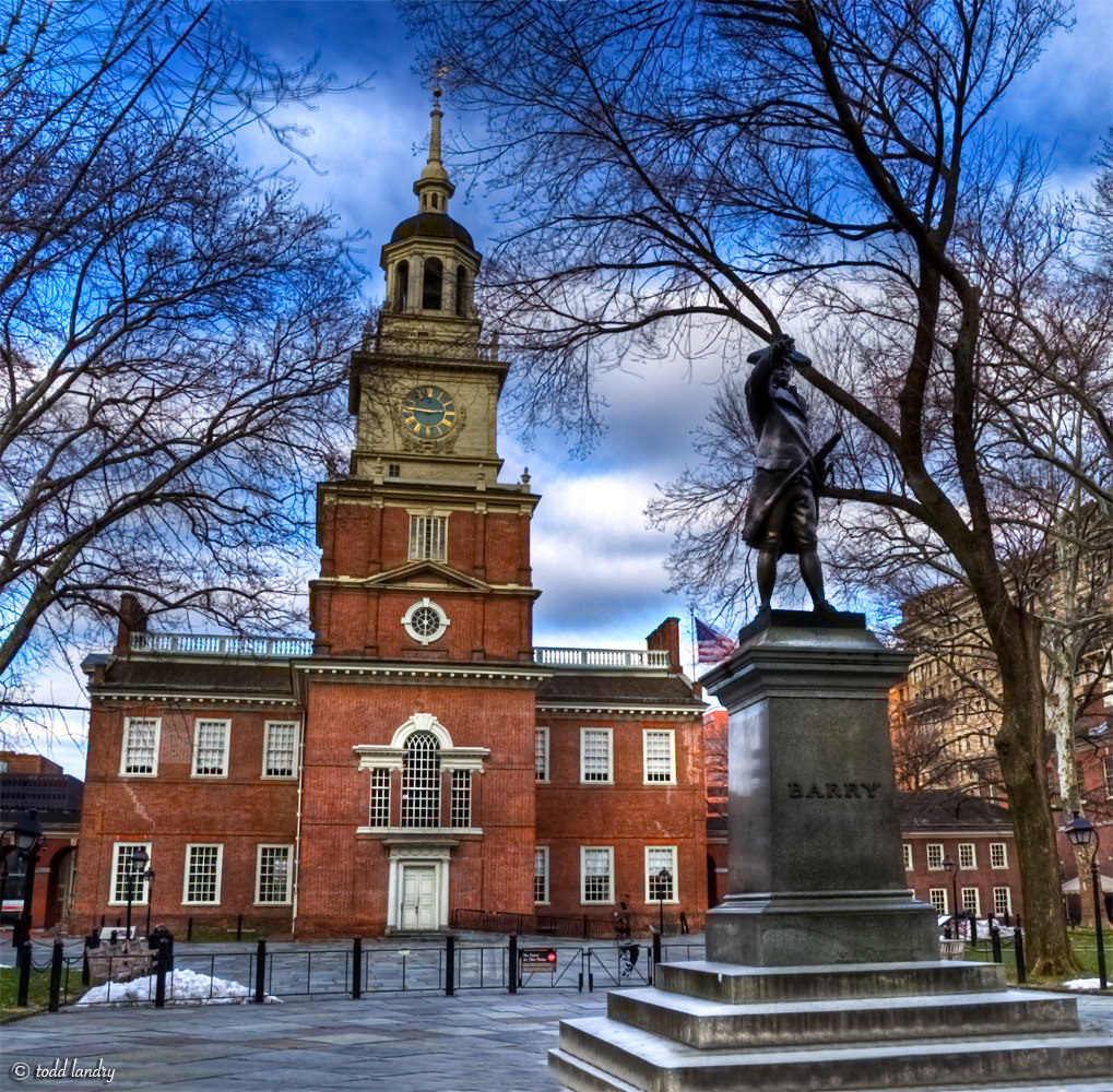 The bronze statue of John Barry (1745-1803) in Independence Square was sculpted by Samuel Murray (1869-1941), the artist who produced the statue of George Washington in front of Independence Hall. The statue was commissioned by the Friendly Sons of St. Patrick of Philadelphia, who then donated the statue to the City. The piece was modeled by Murray, probably in Philadelphia, in 1906. It was cast by the Roman Bronze Works of Brooklyn, NY. The pedestal was built by the Harrison Granite Co. of Barre, VT. A crowd of 15,000 witnessed the unveiling of the statue on March 16, 1907. Photo taken on January 5, 2010.