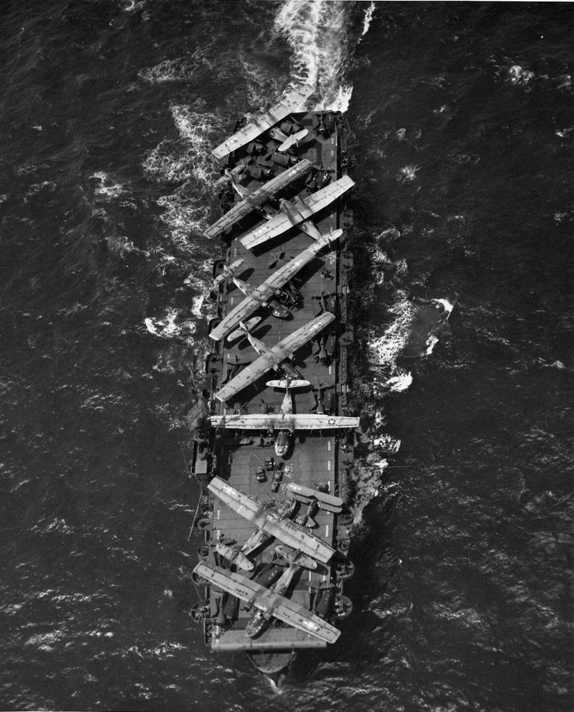 Escort Carrier USS Thetis Bay taking PBY Catalinas, F6F Hellcats, and one J2F Duck from Hawaii to Alameda for repairs, 8 July 1944.