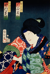 One of the portrait from the collection of portraits, Portraits of Actor by Toyohara Kunichika (1835-1900), a traditional Japanese Ukyio-e style illustration of a woman in colorful clothing. Digitally enhanced from our own original edition.
