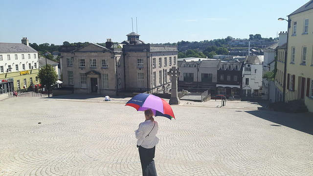 Lady with an umbrella in the market square of Armagh, Northern Ireland.