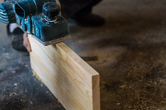 Man operating a wood planer