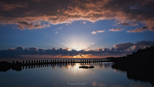 sunset sky water dawn dusk nature landscape reflection outdoors sun sunrise evening cloud pier outdoor horizon calm clouds redsky cloudy bridge afterglow weather atmosphere large background scenery going travel crossing