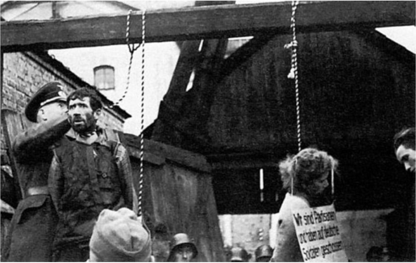 1941. Минск. Первая публичная казнь на оккупированных территориях.Казнь совершили добровольцы 2-го батальона полицейской вспомогательной службы из Литвы, которыми командовал майор Импулявичюс