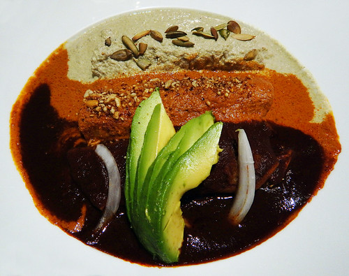 Three great Moles (sauces) in Poblano cooking: mole, pipian, and adobo, here combined into one meal