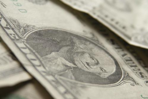 US dollar bills scattered