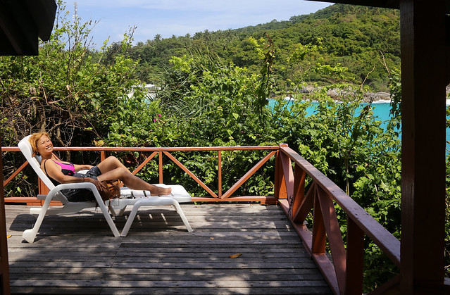 Kanitha sunbathe at our bungalow on Raya Resort
