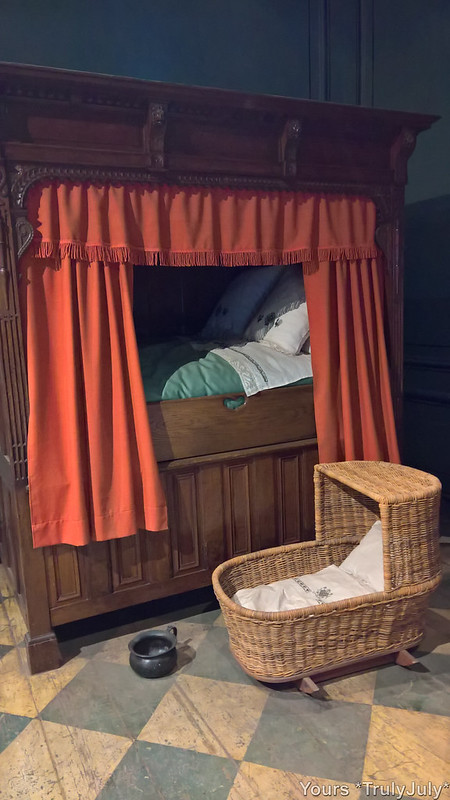 The bed with chamber pot.