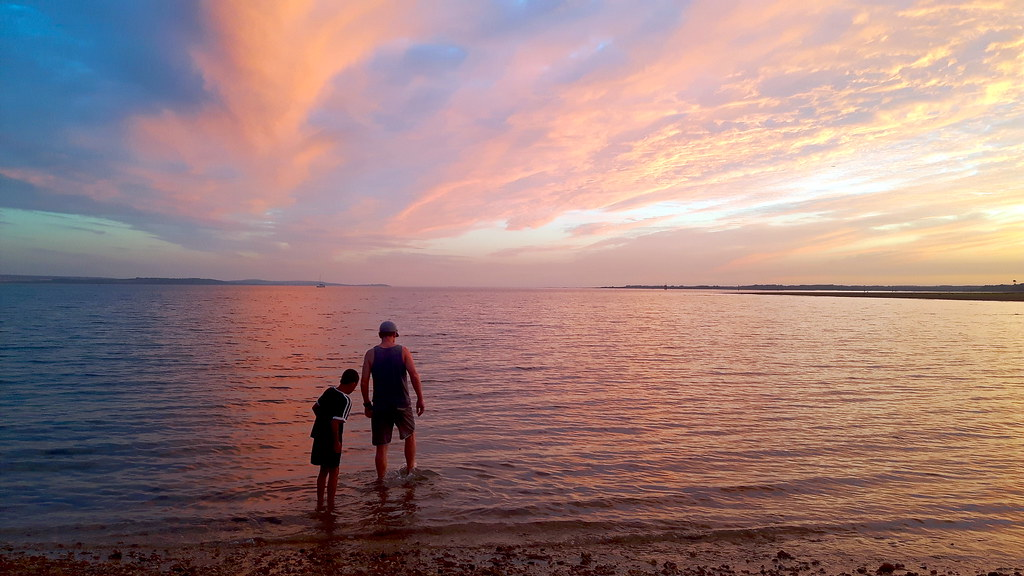 wading in Lepe Beach at sunset, New Forest