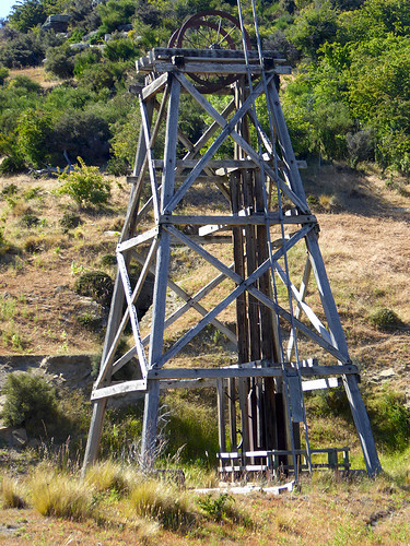 An old historic timber lift tower as part of the mechanism left over from Gold Mining tunnelling near Oturehua on the Otago Rail Trail in new Zealand