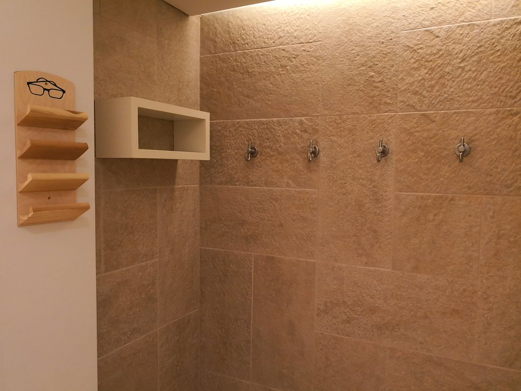 Shower area with glasses holder