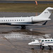9H-III Global Express and ,D-IATE C406 parked on the  Elmdon apron Birmingham Airport.