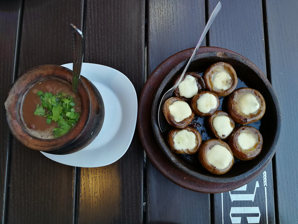 Lobio (bean soup) and baked mushrooms filled with sulguni cheese