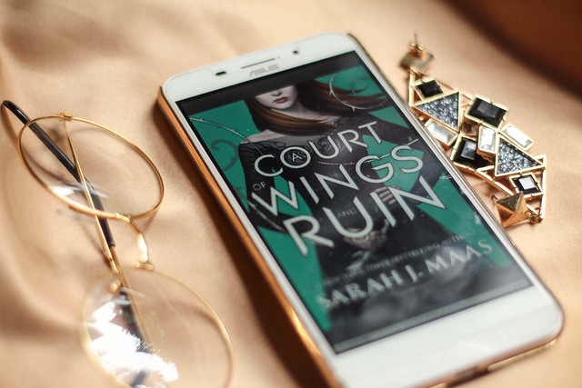 a court of wings and ruin by sarah j maas, flatlay