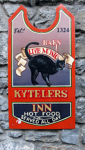 Pub sign with a black cat in Kilkenny, Ireland
