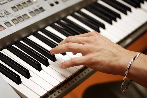 pianist's hand at the keyboard