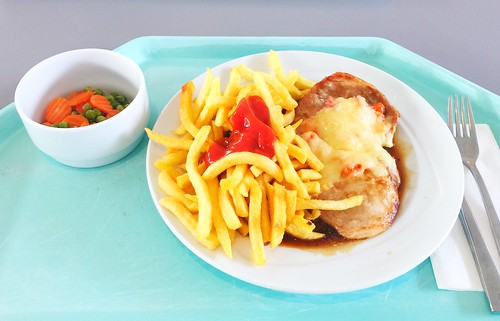 "Pork steak ""Tessin"", gratinated with ham, tomato & cheese with gravy & french fries / Schweinesteak ""Tessin"" mit Tomate, Schinken & Käse gratiniert, dazu Bratensauce & Pommes Frites"