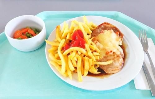 """Pork steak """"Tessin"""", gratinated with ham, tomato & cheese with gravy & french fries / Schweinesteak """"Tessin"""" mit Tomate, Schinken & Käse gratiniert, dazu Bratensauce & Pommes Frites"""