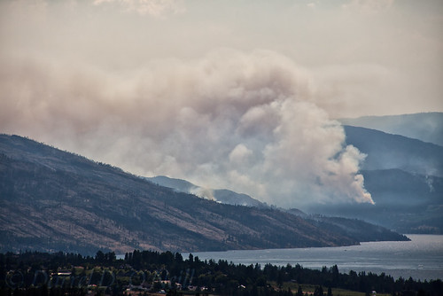 landscape scenic mountains hills water lake trees forest fire forestfire wildfire smoke burning grey gray brown green blue kelowna bc canada okanagan valley