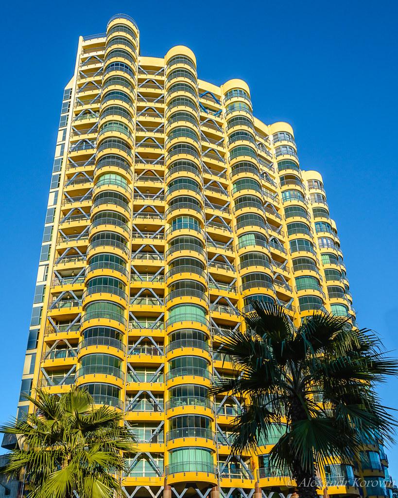 Modern multi-storey building of glass and concrete of original design
