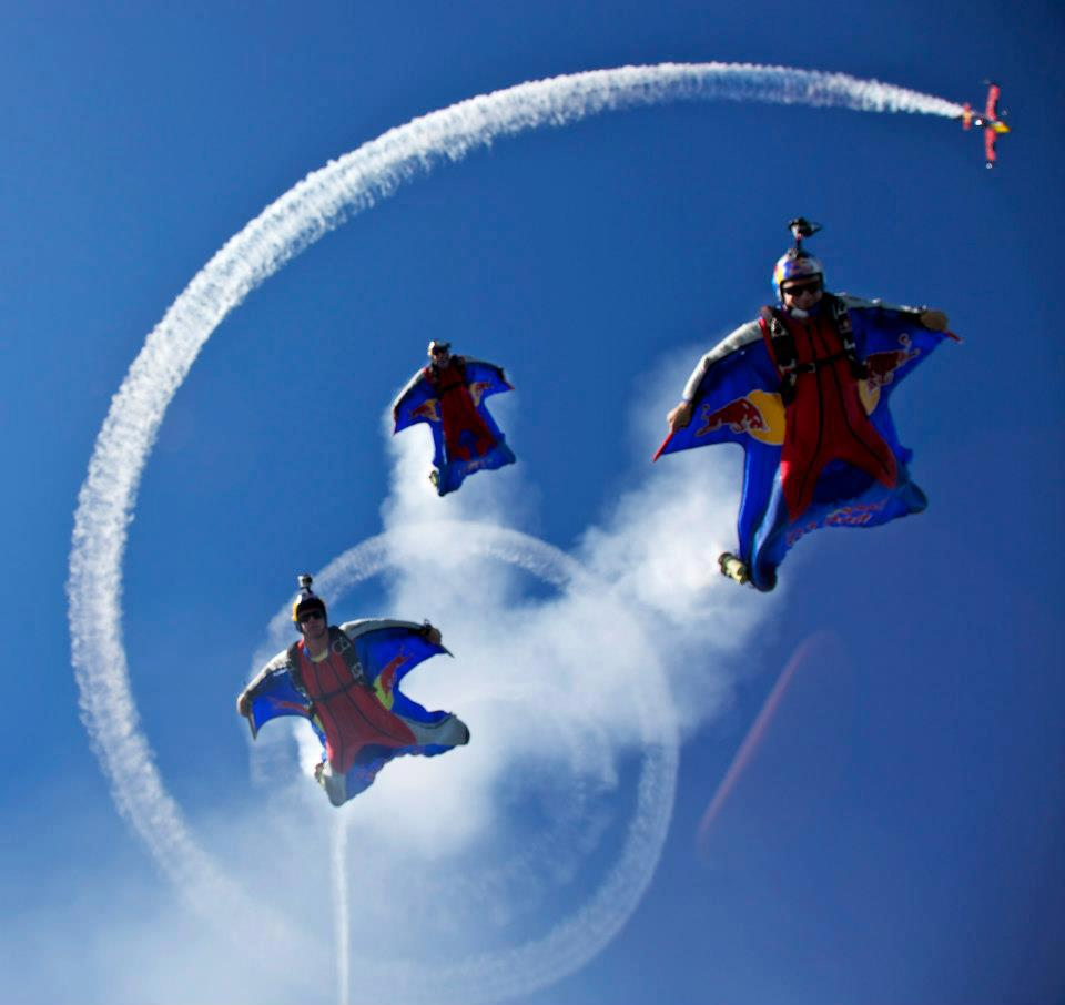 Three wingsuit jumpers flying together