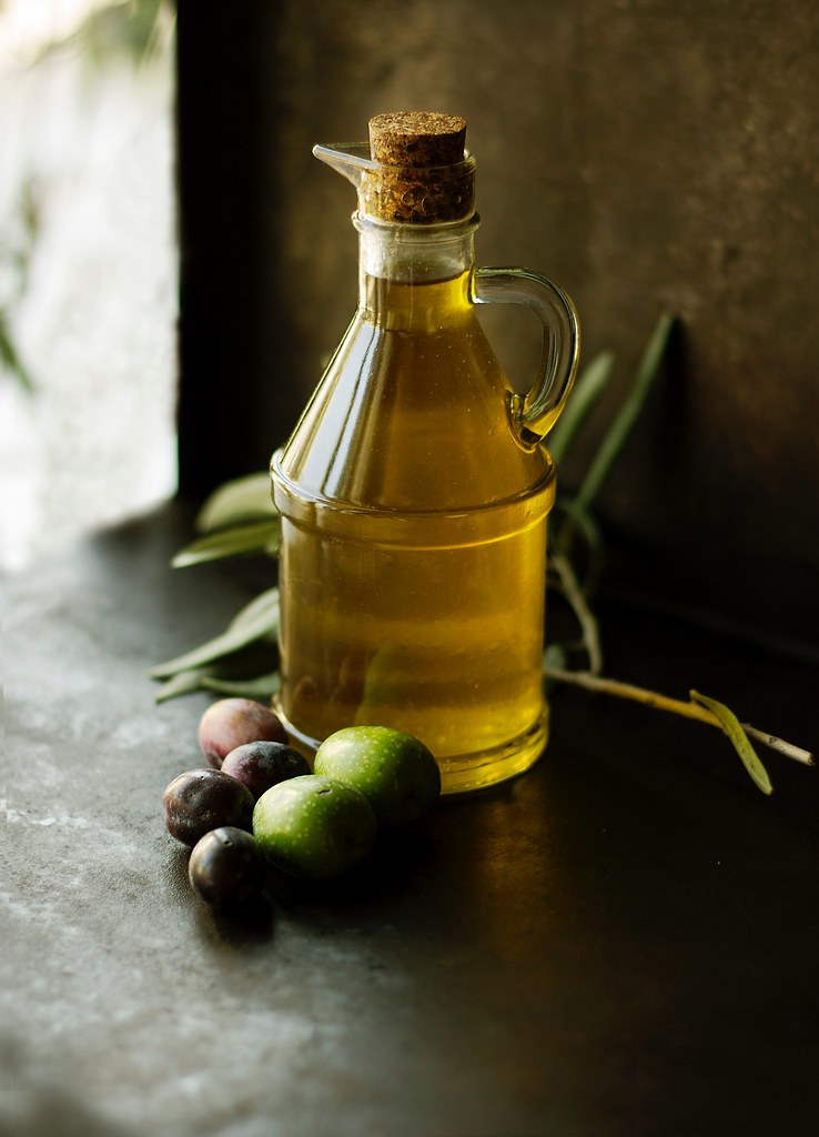 extra virgin olive oil on table