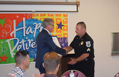 Rep. Ackert presents Sgt. Michael McDonagh with a legislative citation during a retirement ceremony.