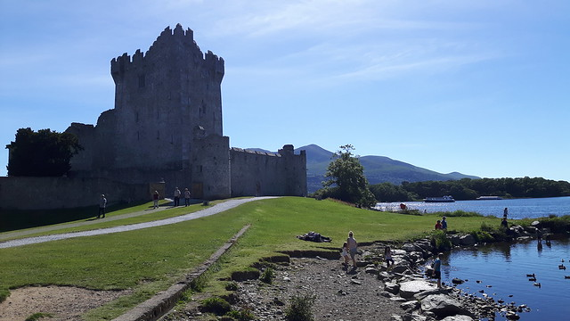 Sunny day at Ross Castle in Killarney, Ireland, on the edge of the lake.