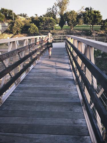jcutrer pedestrian bridge light dramatic dusk evening texas sanangelo fitness outdoors woman running exercise path jogging