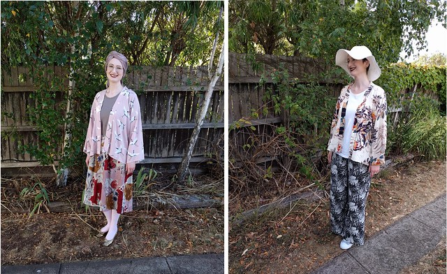 A woman stands in front of a garden fence. She wears a pink crane print kimono jacket, pink skirt, tights and gold glitter shoes with a headscarf. Next photo: She wears a neutral print kimono jacket, wide sunhat, white tee and rayon fern print pants.
