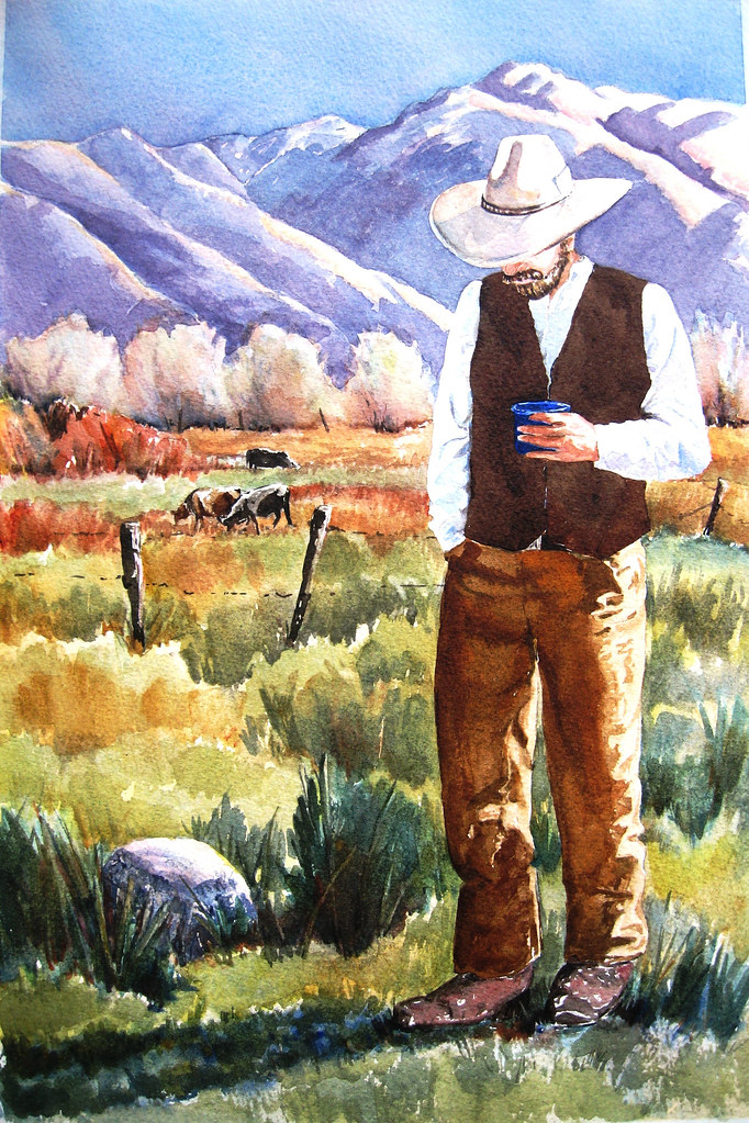 A cowboy takes an early morning coffe break in Round Valley.